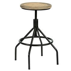 Our vintage Nya Backless Stool is based on a Paris antique. The caned mango wood swivel seat adjusts in height by a screw mechanism underneath. Sturdy iron frame has a footrest that runs all the way around so you can sit comfortably from any direction.Nya Backless Stool features:Weather oak finishBlack iron frameFully assembled