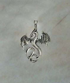 Decorate your favorite chains and necklaces with the mythical whimsy of this fierce dragon pendant, cast from sterling silver for enduring shine.