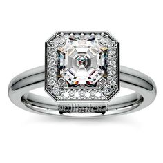 Gorgeous diamonds contrast beautifully with a simple durable band, making the Asscher-cut Halo Diamond Engagement Ring in a sturdy Platinum setting a great choice for the sensible bride-to-be with a fondness for sparkle!