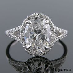 Micro Pave set diamond vintage inspired engagement ring semi-mount, shown custom designed for 1.18 carat oval center    Mounting features approximately 0.60 carats of G-H color / VS-clarity Micro Pave set round brilliant cut white diamonds