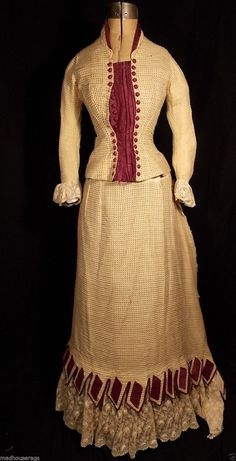 TWO BUSTLE GOWNS, 1870's, 1880's, MAROON, IVORY RIBBON TRIM
