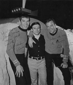 An entertaining autographed shot from 1966 of Leonard Nimoy, William Shatner, both in costume, and Harlan Ellison between them