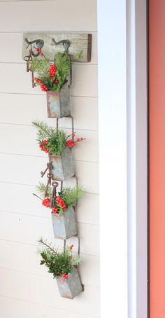 Christmas door hanging made with old cistern, by Julia M. Usher