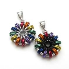 Rainbow chainmaille pendants by TattooedAndChained, starting at $20.00.