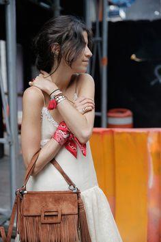 Drop waist dress, bandanna tied around the wrist, fringe bag.