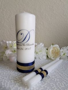 Check out this item in my Etsy shop https://www.etsy.com/listing/532872793/navy-and-gold-personalized-unity-candle