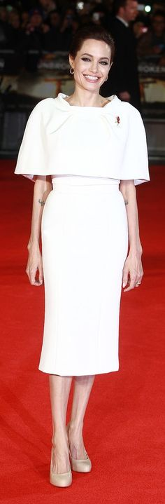 Angelina Jolie looks chic in a white dress at the Unbroken premiere