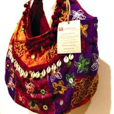 embroidered bag with cowry shell detailing