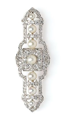 Art Deco Platinum, Pearl, and Diamond Brooch, set with old European- and old mine-cut diamonds, and centering a line of pearls graduating from approx. 4.00 to 6.10 mm, lg. 2 5/8 in.