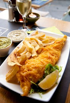 Can't beat good old English tradition... Fish and chips!! With mushy peas! And loads of salt and vinegar