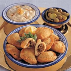 Recipe - Fried Meat Sambousek - Place flour in a deep bowl, add sugar, salt, butter and mix well with your fingertips until it resembles fine breadcrumbs. .