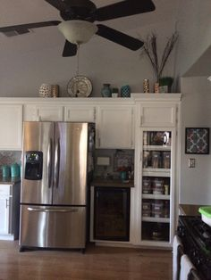 Loving my white cabinets. A little decor on top. French Door Refrigerator, White Cabinets, French Doors, Kitchen Appliances, Top, Decor, White Dressers, Diy Kitchen Appliances, Home Appliances
