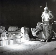 Behind the scenes of a Godzilla movie.  About 1960, Japan