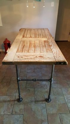 Old barn door turned into a table with pipes!