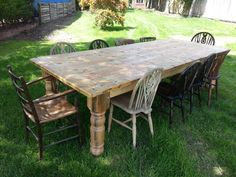 Victorian style table with a selection of odd antique chairs.