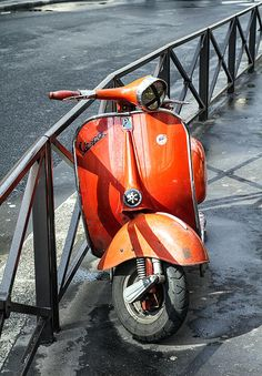 Fine art photography of a bright orange vintage Vespa scooter in Paris by Georgia Fowler.