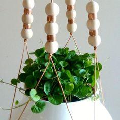 wood and copper plant hanger