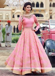 Add a adolescent burst of colour for any wardrobe with this silk designer gown. The ethnic print work over a clothing adds a sign of splendor statement for the look. (Slight variation in color, fabric...