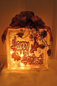 """Custom Decal Ideas from Pinterest - """"This was a """"Happy Harvest"""" glass block with vinyl lettering, a small strand of Christmas lights and ribbon."""" - https://www.etsy.com/listing/124790919/custom-vinyl-lettering-vinyl-decals?ref=shop_home_active"""
