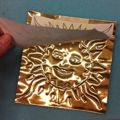 aztec suns, gold foil. no special tools needed, except felt or other cushion under foild to transfer image