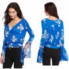 Free People Top Super cute deep V neck top with Bell sleeves and tie at side. Beautiful blue color! Free People Tops Blouses