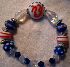 Giants Football Beaded Bracelet; football themed bracelet; Giants jewelry; Giants themed bracelet; Giants lampwork beaded bracelet by FarringtonBead on Etsy