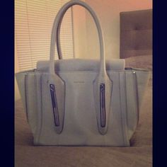 Pour La Victoire gray handbag Beautiful gray convertible Pour La Victoire handbag. The sides zip up so you can make it into a smaller square bag. Never been used. Lots of room on the inside; one zip pocket and two other open pockets. Pour la Victoire Bags Shoulder Bags