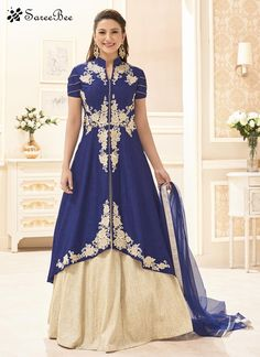 Add grace and charm towards the look in this charming Gauhar Khan navy blue banglori silk long choli lehenga. This desirable attire is displaying some fantastic embroidery done with embroidered, lace ...