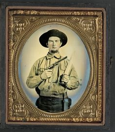 Unidentified soldier in Confederate uniform with Colt Navy revolver and double handle D-guard Bowie knife. Liljenquist Family Collection of Civil War Photographs; Ambrotype/Tintype photograph filing series; Library of Congress Prints and Photographs Division.