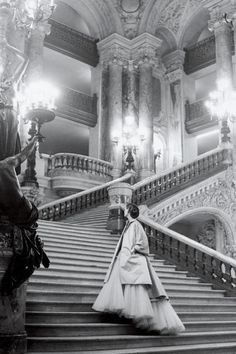 Christian Dior's tulle ballgown on the grand staircase at the Paris Opera, 1948.