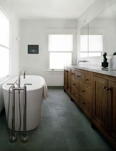baths-dark-wood-green-white-bathtubs-countertops-freestanding-bathtubs-marble-bathrooms