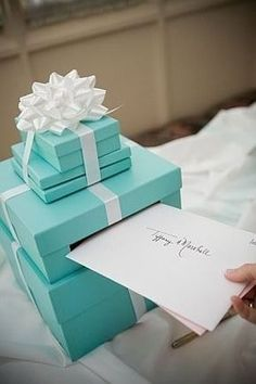 Such a great idea for guests to place their cards.  Very cost efficient.  Look for boxes and ribbon at Michaels.