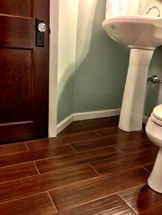 Tiles that look like wood but have the durability of tile for a bathroom. Available at Lowes. - interiors-designed.com