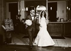 bride and groom enter reception with grand entrance