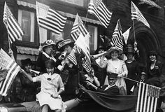 Suffragettes Celebrate the Passing of the 19th Amendment: On August 26, 1920, the 19th Amendment to the Constitution was finally ratified, granting American women the right to vote.