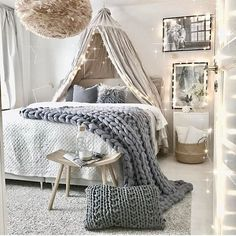 I like how your eye is first drawn to the bed, but the colors and lighting allow you to notice small accents like the twinkling lights in the canopy and the pictures on the wall. It's simple yet elegant.