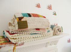 Baby blankets on a shelf in Sofi's room...?