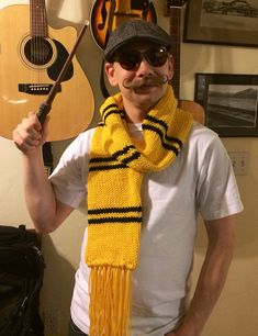 Hogwarts Hufflepuff Scarf  the Later Years by AnniePants on Etsy, $48.00 - Hand knit and full of magic! And of course the model has a fabulous mustache.