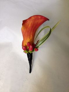 A single flame calla with hypericum and variegated lily grass by Seasonal Celebrations. http://www.seasonalcelebrations.com