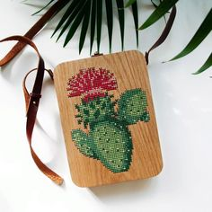 GRAV GRAV is an Istanbul-based woodworking studio. Inspired by nature, I create uniquely spirited wooden bags, handcrafted with natural materials like walnut, oak and beech. Wooden purses, clutches and backpacks are adorned with needlepoint, embroidery and leather details.