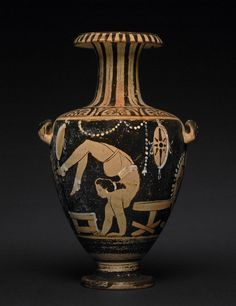 Pottery: red-figured hydria . Design red on black ground, with white accessories. On the neck, tongue-pattern; on the shoulder and at the back, palmettes. Female tumbler to left, in the act of turning a somersault, standing on her hands with feet over her head; her hair is tied in a bunch, and she wears earrings, white belt, close-fitting garment over hips, and white bands round her ankles and insteps. Before her is a stool, and behind, a small table (or potter's turn-table); British Museum