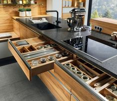 Linee Kitchen - The overall look is clean and modern, the horizontal lay of the grain creates a contemporary feel, as do the cubic bar handles (optional).
