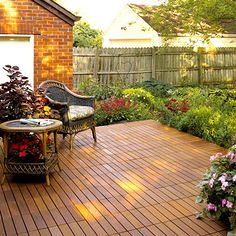 Loving low deck surrounded by pretty plants - exactly what I want for my back yard!!  Come on landscaping elves! Lovely!