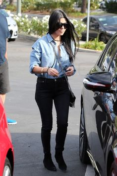 Kourtney Kardashian wearing  McGuire Denim Hideaway Shirt, McGuire Denim Inez Patch Skinny Jeans, Saint Laurent Snake Crossbody Bag, Saint Laurent Rock Zip Ankle Boot