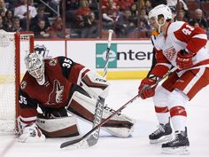 Arizona Coyotes' Louis Domingue (35) makes a save on a shot by Detroit Red Wings' Luke Glendening (41) during the second period of an NHL hockey game Thursday, Jan. 14, 2016, in Glendale, Ariz.  Ross D. Franklin, Associated Press