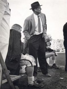 """In this Sept. 27, 1958 photo, Alabama coach Paul """"Bear"""" Bryant looks on during a college football game against LSU at Ladd Stadium in Mobile, Ala. It was coachBryant's first game in charge of the Crimson Tide, and one that flashed promise for a rebuilding program. For visiting LSU, it was an early step toward an undefeated season and national title. Photo: Anonymous, AP File Photo / AP2008"""