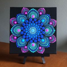 Flower burst dot mandala on black 6 x 6 canvas board blue, magenta , turquoise Excited to share this item from my shop: Flower burst dot mandala on black x canvas board blue, magenta , turquoise This beautiful representation of a mandala is an original de Mandalas Painting, Mandala Drawing, Drawing Flowers, Painting Flowers, Mandala Art Lesson, Mandala Painted Rocks, Mandala Rocks, Flower Mandala, Flower Art