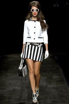 """""""Optical designs, with bold black & white vertical stripes."""" Moschino Spring 2013 RTW"""