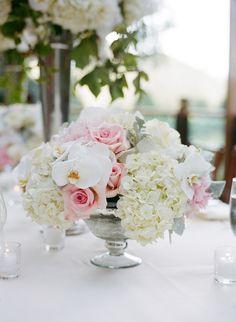 Low wedding reception centerpiece, white & pink flowers. Hydrangeas, roses, orchids. Wedding Calistoga Ranch, Napa. Floral design by Fleurs de France. www.fleursfrance.com Photo: Meg Smith