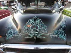 Pinestriping Skull work on a 1950 Chevy.